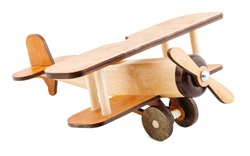 A mock-up of a children's airplane made of wood isolated on white background. The concept of children's toys. Retro Toys