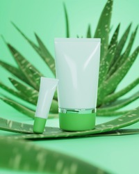 A mock up of realistic blank cosmetic tube isolated on bright green alo vera background, 3d rendering , 3D illustration