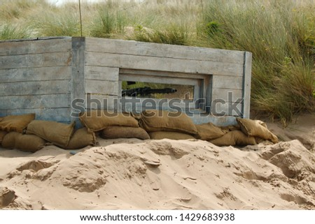 A mock WW2 period pillbox, complete with machine gun and sandbags
