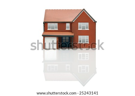 A model house isolated on a white background with reflection