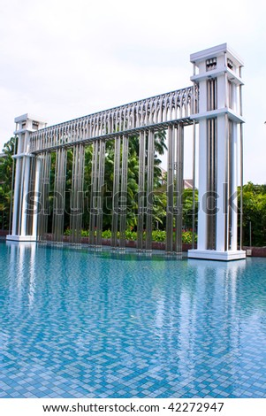 A modern architecture on a pool of water