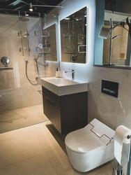 A modern bathroom design, with a unique LED backlit mirror.