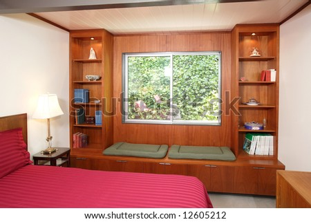 A modern bed room with dark wood walls #12605212