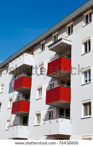 A modern building with balconies. Living in apartments and condos