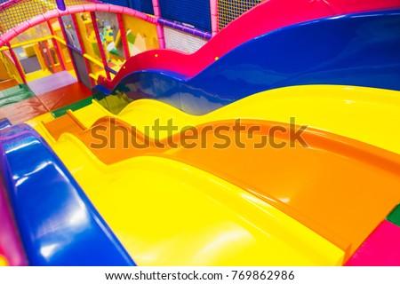 A modern children playground indoor with long slide . children's playground . kindergarden playground #769862986