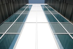 A modern commercial building looking up showing reflections on both sides