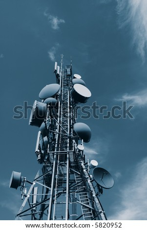 A modern communications tower in blue tone.