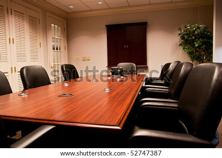 A Modern Conference Room With Leather Chairs And Mahogany Table Stock Photo 5
