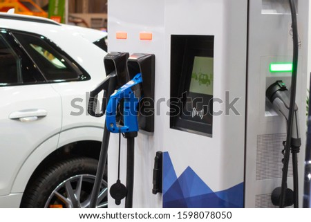 A modern electrical fast charger for the electrical or hybrid PHEV automobiles. An Energy power of future. Ecology friendly charger concept. Home electric car battery charger. Stock photo ©