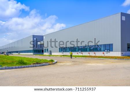 A modern factory building #711255937