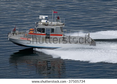 A modern fireboat moving at speed.