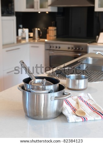 A modern kitchen being used for food preparation