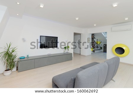 A modern living room with a table and fancy sofa