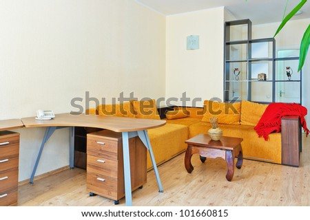 A modern living room with table and sofa