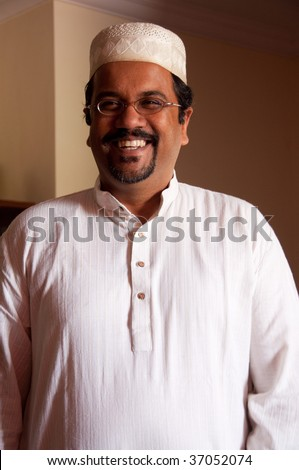 A modern Muslim man wearing traditional dress