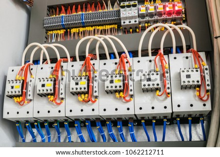 A modern open fuse box contains a lot of automata, connectors, relays, and magnet starters. Distributive electrical box.
