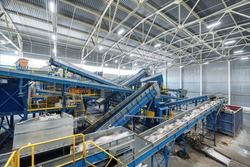 A modern plant for sorting and recycling household waste and waste. Large industrial complex of conveyors, bunkers.