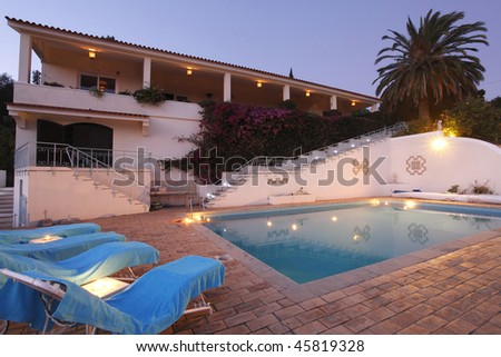 A modern residence with candles in the swimming pool - Lifestyle concept - stock photo