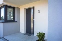 A modern single family house with a entrance doors