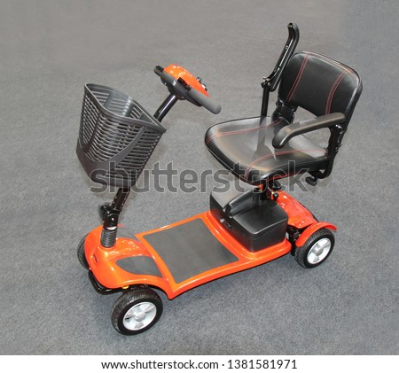 A Modern Small Wheeled Electric Mobility Scooter. #1381581971
