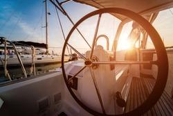 A modern speed boat yacht steering wheels. Background