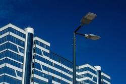 A modern street LED lighting pole. Urban electro-energy technologies. Savings on street urban road lighting. Energy saving. High tech. Eco-friendly smart city system.