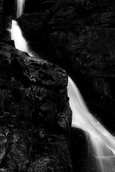 A monochromatic waterfall in the heart of the Derbyshire countryside. The long exposure water juxtaposes the harsh textured rocks / plants.