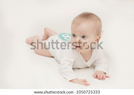 A 8 Month Old Baby Girl, in front of a White Background, Sticker 8 Month  Stock photo ©