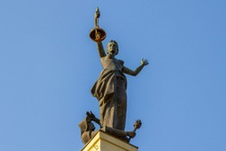A monument to feminism. Old Vilnius Power Plant. Lamp in Hand. Beautiful Woman Statue Images.