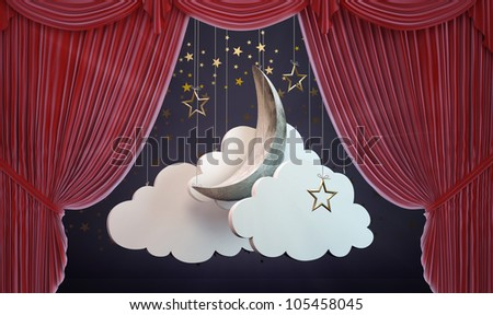 A moon and clouds stage set behind an opening Theater curtain