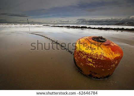 a mooring buoy washed onto the beach during a storm on north wales coast
