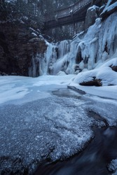 A morning blue hour shot of Elakala Falls in Blackwater Falls State Park, West Virginia.