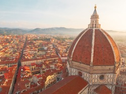 A morning mist lay over the Florence city and Cupola of the Florence Cathedral (Cattedrale di Santa Maria del Fiore or Cathedral of Saint Mary of the Flower) in Florence, Italy.