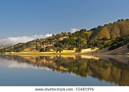A morning reflection of the rolling hills and chaparral of the central California coast