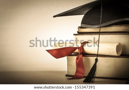 a mortarboard and graduation...