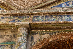 A mosaic in ruins of Ancient Roman city Pompeii, Campania region, Italy. City destroyed by the eruption of Mount Vesuvius. A room in Suburban Baths decorated with beautiful mosaic and white seashells
