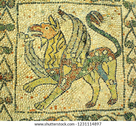 A mosaic of the mythical creature griffin. The mosaic is one of the old Byzantine mosaics in Ravenna, Italy. These were done around 5th-6th century AD. #1231114897