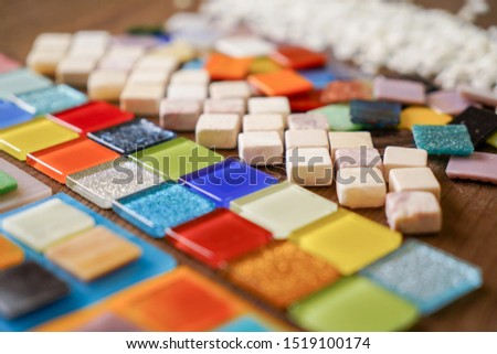 A mosaic tiles by different colors is prepared for making a picture