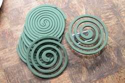 A mosquito coil is a mosquito-repelling incense, usually made into a spiral, and typically made using dried paste of pyrethrum powder. The coil is usually held at the center,suspending it in the air.