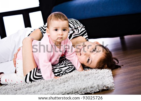 a mother and baby daughter studio portrait
