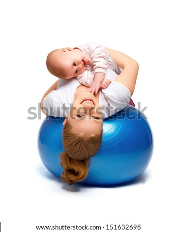 A mother and baby doing gymnastic exercises on the ball