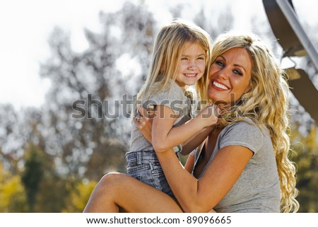 A mother and daughter enjoying a day at the park