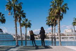A mother and her daughter enjoying the views from the Muelle Uno Port, in Málaga