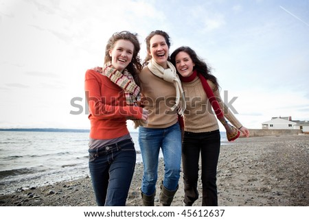 A mother having fun with her daughters on the beach