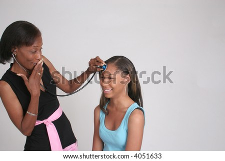 A mother is listening to her daughter's thoughts via a stethoscope