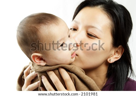 A mother kissing her cute baby son
