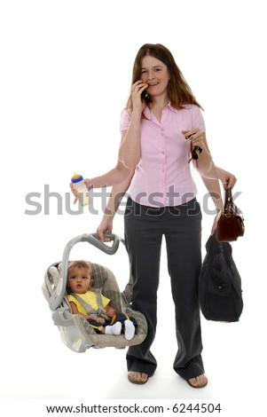 A mother multi-tasking with six occupied arms.  Focus on woman.