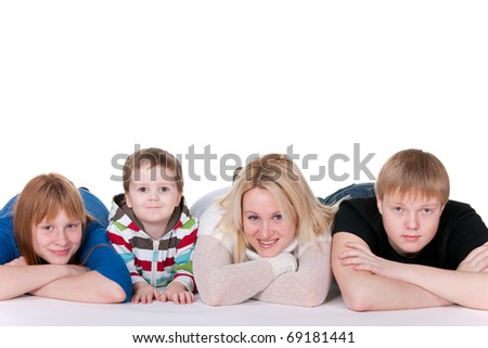 A mother, two sons and daughter are smiling, lying on the studio floor; isolated on the white background