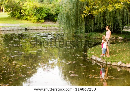 A mother with daughter and son at park