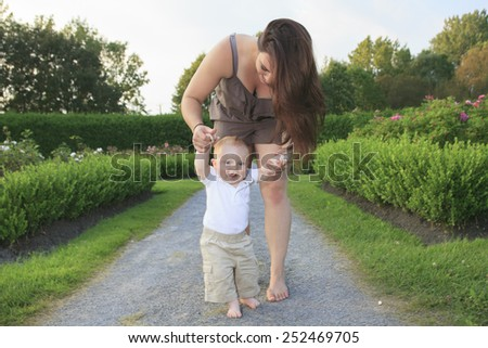 A mother with is baby on a beautiful forest